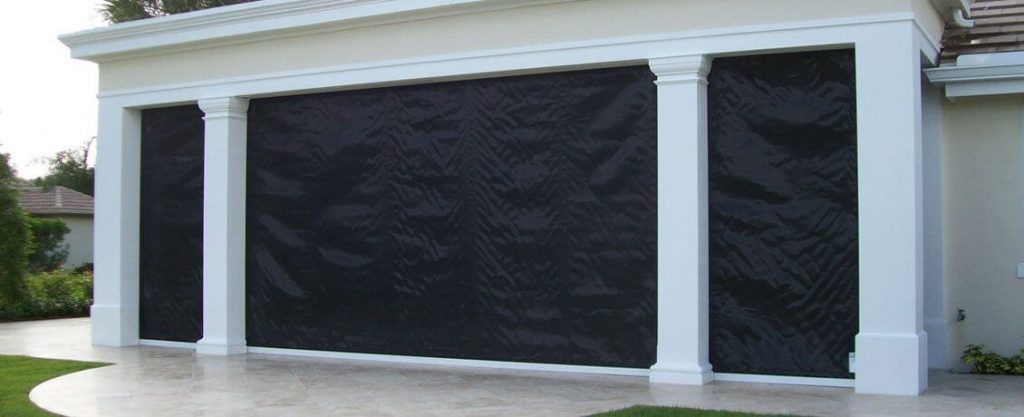Beautiful home protected lanai with black hurricane screen